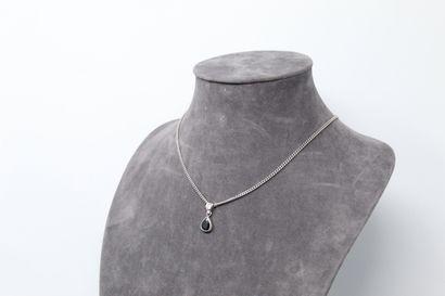 Pendentif en or gris 18K (750) orné d'un...