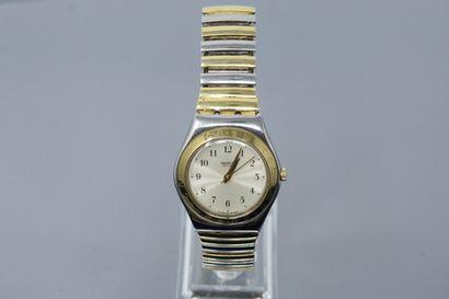 SWATCH  Montre bracelet en acier, boîte d'origine....
