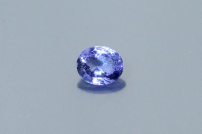 Oval Tanzanite on paper.  Weight : 5.17 ...