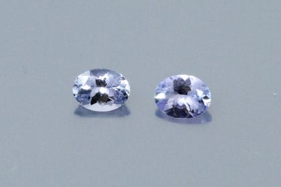 Pairing of oval tanzanites on paper.  Accompanied...