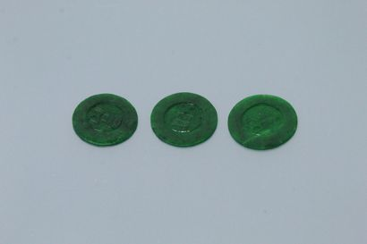 Lot of three round jade plates engraved with...