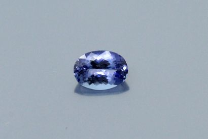 Oval Tanzanite on paper.  Weight : 3.03 ...