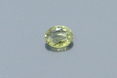 Oval yellow sapphire on paper.  Accompanied...