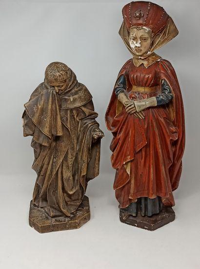 Ensemble de deux sculptures de personnages,...