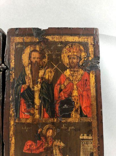 ICÔNE DOUBLE, tempera sur bois et charnière métal, représentant à gauche la Vierge...