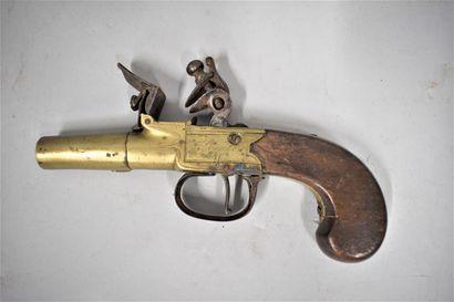 Pistolet coup de poing à silex et à balle...