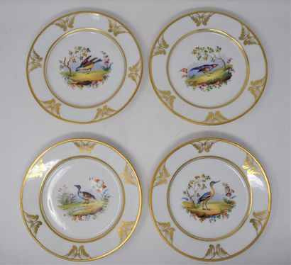 Suite de dix assiettes en porcelaine à décor...