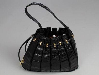 BOL-PERDIX    Accordion bucket bag carried by hand in a black glazed crocodile style,...