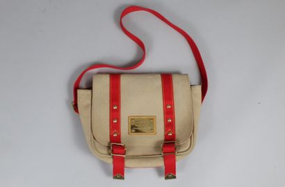 LOUIS VUITTON    Shoulder bag Antigua model in beige and red canvas, golden fittings....