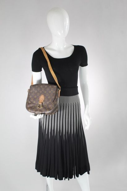 "LOUIS VUITTON  Shoulder bag ""Saint Cloud"" model in natural leather and monogrammed..."