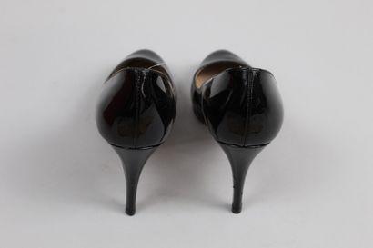 VALENTINO    Pair of black glazed leather pumps.  Worn.    Size : 36    Heel height...