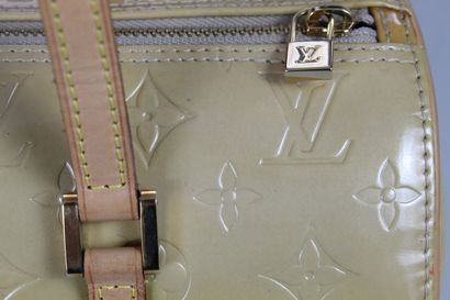 LOUIS VUITTON    Bedford model inspired by the Papillon model in natural leather...