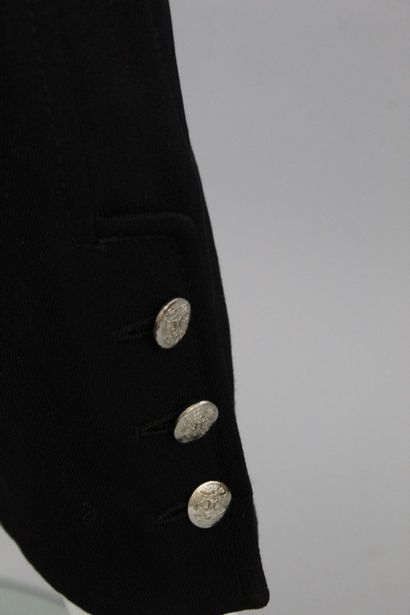 CELINE    Pantalon carotte en laine mélangée noire, deux poches à l'italienne et...