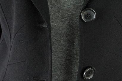 CELINE    Veste noire en laine à maille fluide, à détail de pattes géométriques...