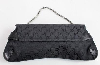 """GUCCI    Sac modèle """"Mors"""" en cuir noir et toile monogrammée """"Guccissima"""" noire,..."""