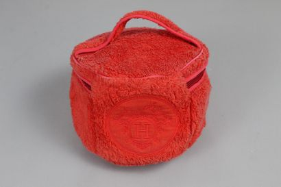 HERMES    Round vanity in orange terry towel.  Embroidery with the house coat of...