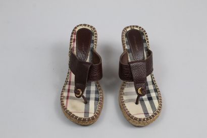 BURBERRY    Pair of tan leather mules/tongs with rope heel.    Size : 36    Height...