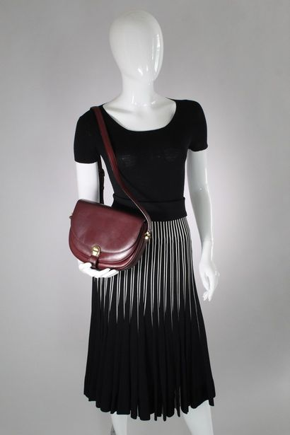 AIGNER    Messenger bag in burgundy box leather, worn on the shoulder or across...