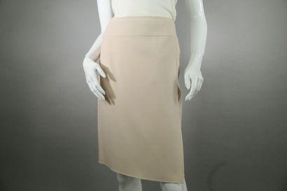 CELINE    Powder pink wrap skirt in wool blend jersey. Decorative details imitating...