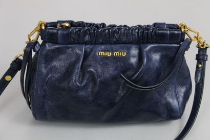 MIU MIU    Hand or shoulder bag (removable) in midnight blue leather with gathers,...