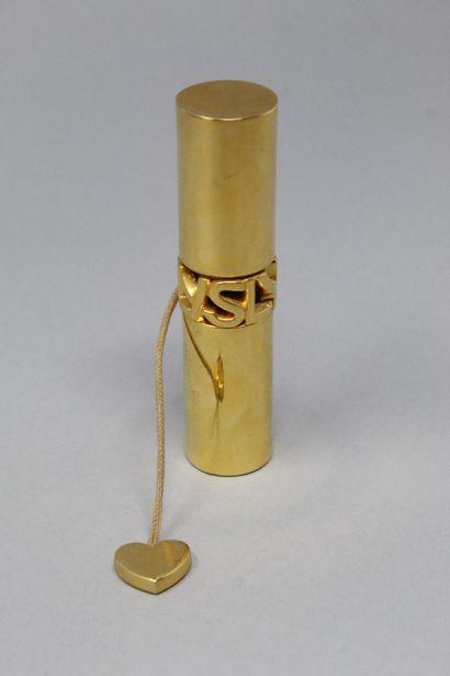 YVES SAINT LAURENT  Vaporisateur de parfum en verre dans un étui en métal doré signé...