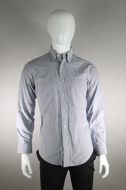 ARROW    Chemise à manches longues en coton bleu chiné. Une poche plaquée.    Taille...