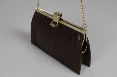ANONYMOUS    Brown reptile purse with jewelled flap clasp.  Chain in gilded metal....