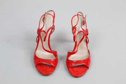 CASCADEI    Pair of red patent leather heels sandals, with a patterned strap around...