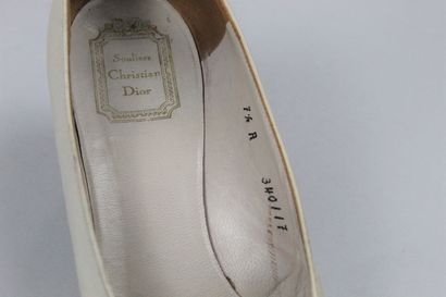 CHRISTIAN DIOR SHOES (Circa 1960)    Pair of cream silk covered pumps with small...