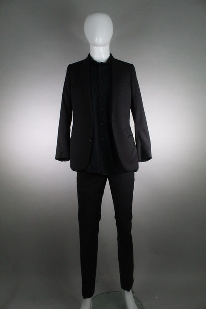DIOR  Black virgin wool suit with thin anthracite stripes.  Double buttoning, one...