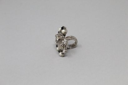 YVES SAINT LAURENT by PILATI  Fancy ring adorned with fancy pearls, black stones...