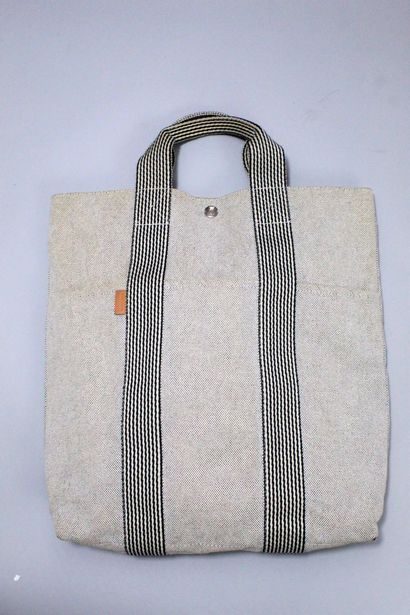 """HERMES    Toto"""" bag, vertical version in mottled grey and black canvas. Two canvas..."""