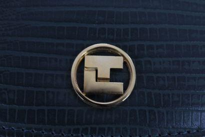TED LAPIDUS (attribué à, licence)    Sac porté main en simili cuir à effet serpent...