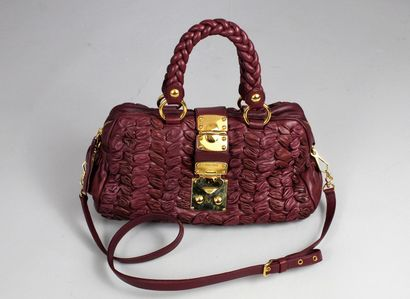 MIU MIU    Raspberry leather shoulder bag with the House's iconic draped quilt....