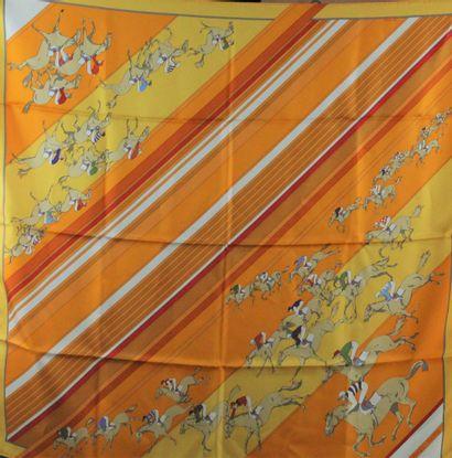 """HERMES    Carré modèle """"Les Courses"""" en soie jaune, orange, rouge et blanche.  Année..."""