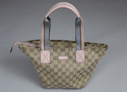GUCCI    Small tote bag in canvas monogrammed GG and pink leather.  Handles in multicolored...