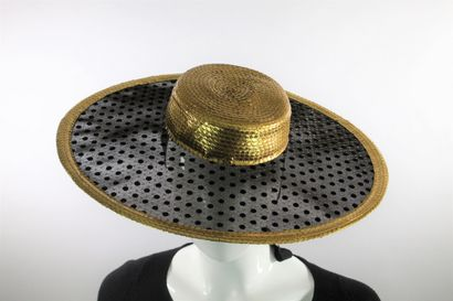 YVES SAINT LAURENT Rive Gauche    Capeline en paille tressée dorée et tissu noir...