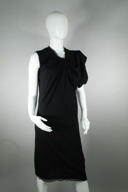LANVIN    Asymmetrical short-sleeved dress in black cotton and silk. The collar...