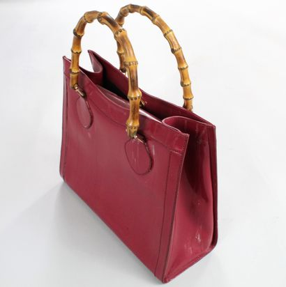"""GUCCI    Bamboo"""" bag in glazed raspberry leather with two bamboo handles emblematic..."""