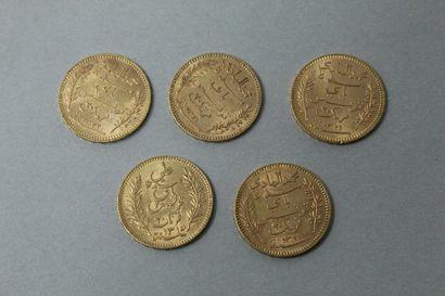 Lot de cinq pièces en or de 20 Francs Tunisie...