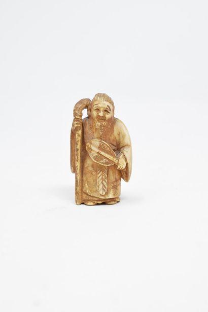 JAPON - XXème siècle  Netsuke en ivoire sculpté...