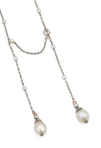 """Collier """"négligé"""" en or gris orné de deux perles baroques, leur monture sertie de..."""