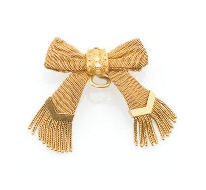Broche en or jaune formant un ruban noué,...