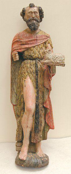 Saint Jean-Baptiste en bois sculpté et polychrome....