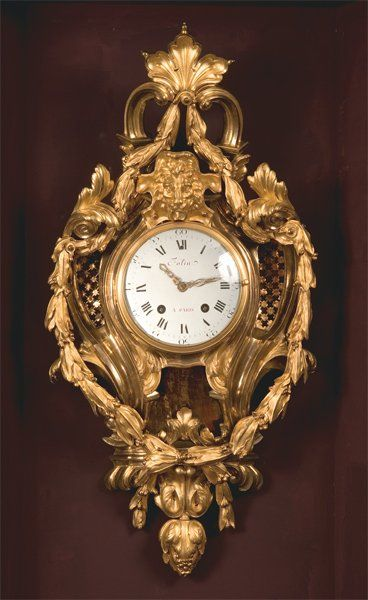 Cartel d'applique en bronze doré à deux ors,...