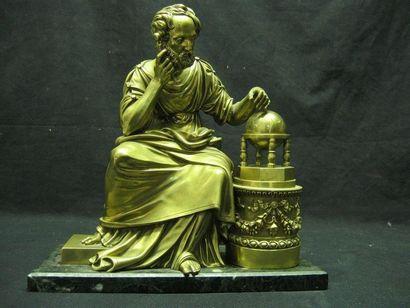 Bronze de pendule figurant un savant vêtu...