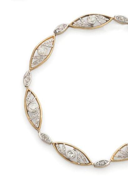 Bracelet en or jaune et or gris formé de...