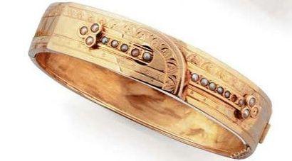 Bracelet jonc rigide et articulé en or jaune,...