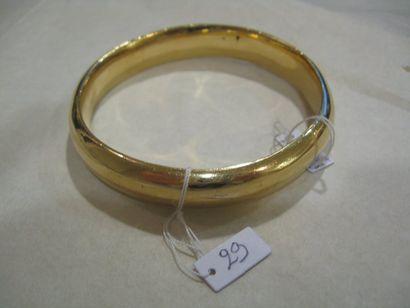 Bracelet jonc en or jaune. Poids : 160 g...