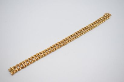 Bracelet en or jaune 18K (750) à maille gourmette...